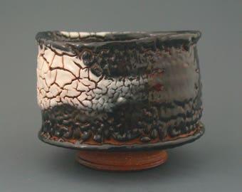 Chawan, wood-fired iron rich stoneware with shino and seto-guro type glazes