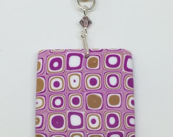 Polymer clay geometric pattern square pendant with a silver plated bail and clasp, a Swarovski bicone crystal and brown suede cord