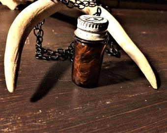Bullsnake specimen bottle necklace