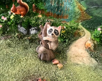 Miniature Raccoon on a Tree Stump
