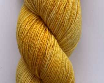 Hand dyed yarn on a merino, nylon base in golden shades of yellow.
