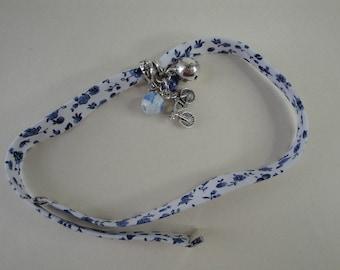 White, blue floral fabric bracelet