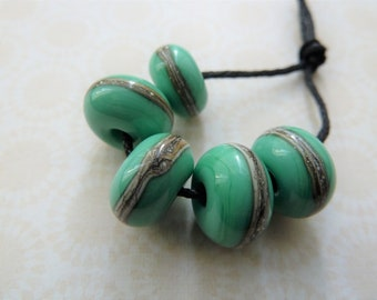 lampwork glass green wrapped bead set, uk handmade