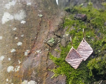 Handmade hammered copper earrings.