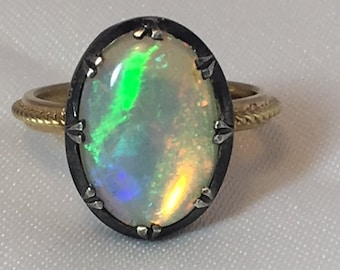 A gold and silver opal ring