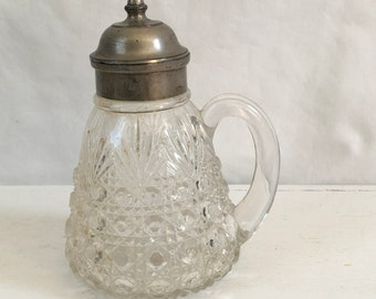 Mold blown antique pattern glass syrup pitcher with pewter lid
