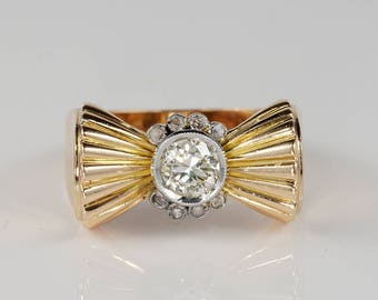 Charming Art Deco solitaire diamond bow ring