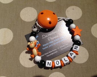 Pacifier clip personalized with name TIGGER star lollipop orange black and white