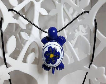 Necklace tortoise indigo flower made of polymer clay.