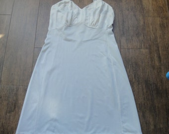 Vintage Movie Star Slip, Size 36, White nylon, Shorter length, Slight A-line, Adjustable straps, Fitted shape, Made in USA