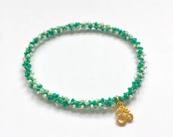 Stackable golden OM yoga charm bracelet Anahata (heart chakra)