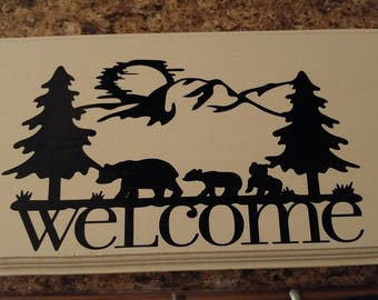 Bear and forest welcome sign