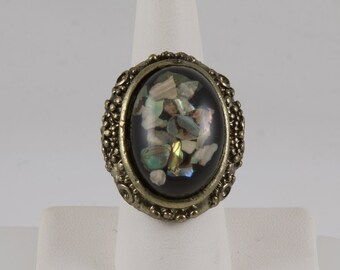 Statement Ring, Dark Gold, Oval shape, Large black resin center Mother of pearl chips Small gold flowers around edge Adjustable