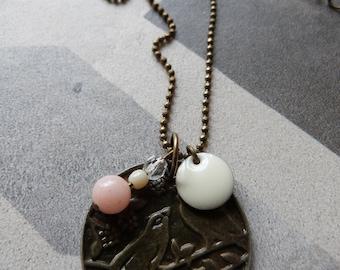 Bird medal necklace