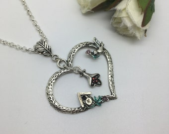 The bird house ~ Love heart necklace with bird, lily and birdhouse.