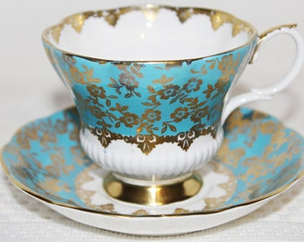 ROYAL ALBERT Turquoise Teacup and  Saucer from Consort Series Turquoise Blue and Gold Chintz Lovely