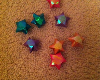 Shiny colourful origami stars