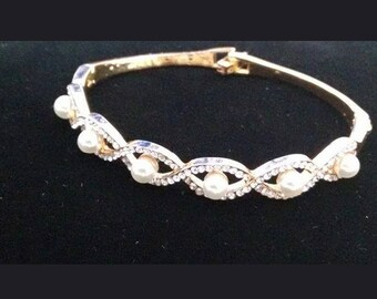 Gold plated bangle with faux pearls and  sparkling twisted rhinestones ...Bespoke item