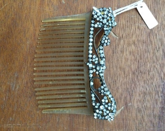 beautiful antique hair comb with simple paste decoration.