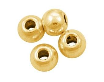 set of 50 gold tone - 6x4mm - dense barrel beads