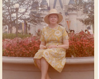 Vintage Photo of a Woman in a Yellow Print Summer dress and Sunhat, Disney Fairy Tale Castle, Color Photo, Snapshot, Landscape