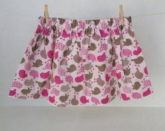 Baby 12 months cotton pink skirt, taupe bird motifs.