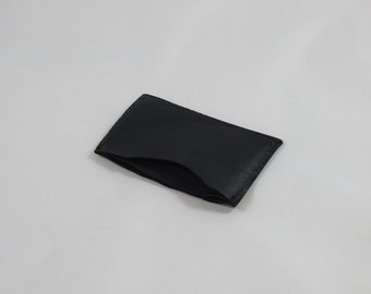 Super thin leather 3 pocket cc card and money holder.