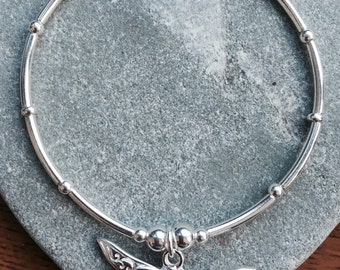 Sterling silver, noodle bracelet with large dragonfly charm.                                                ©Orchid rm 2016