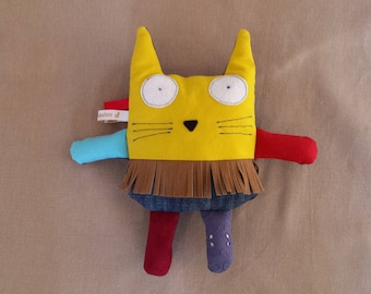 Yellow cat with fringes