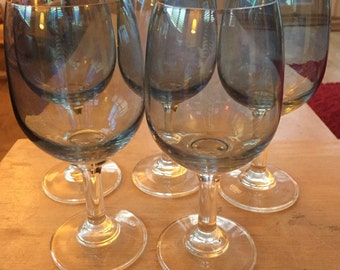 A pretty set of five Krosno Poland wine or water glasses in irredesent blue colour