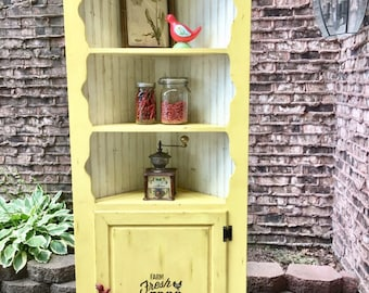 Yellow Country Corner Cabinet. Pick Up Only.