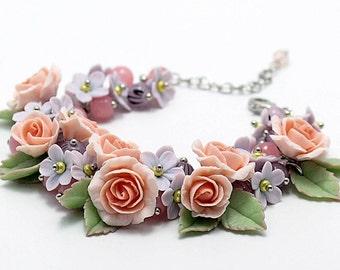 Polymer clay bracelet with roses, myosotis flowers, glass beads