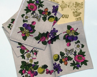 Vintage Kitsch Set of Hedgerow Placemats designed by Pat Albeck - Neon Fruit and Butterflies on a White Linen Background