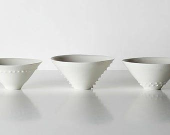 Porcelain bowls with porcelain mugs.