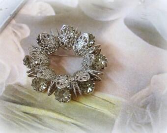 vintage rhinestone wreath brooch . silver tone filigree prong set black diamond rhinestones circa 1960s