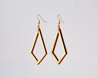 Fly, gold-colored earrings with wooden hangers