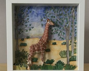 Setting diorama featuring original hand painted and miniature of a giraffe.