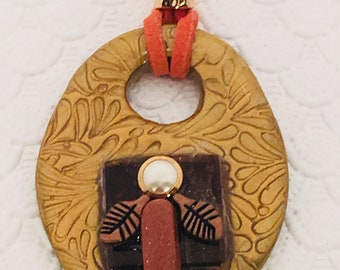 Artistically created hand crafted polymer clay pendant