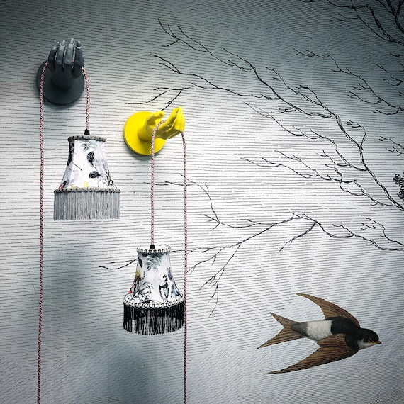 Hand wall lights with lampshade and bulb fitting