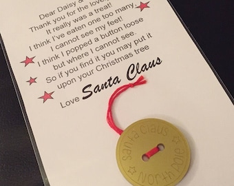 Santa's lost button with a personalised poem for the children from Santa Claus. His button can be gold acrylic like pictured or wood
