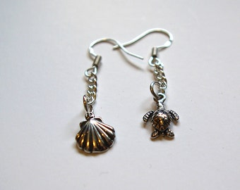 Delicate earrings - one has a turtle and one has a shell, in hallmarked silver.