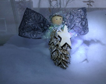 Holiday Angel with the palest of violet wings.