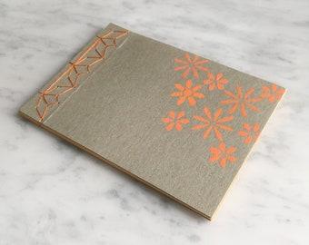 HANDMADE NOTEBOOK A6, Japanese stab-bound with orange cotton, 40 blank pages, orange, white, craft card cover, orange daisy stencil pattern