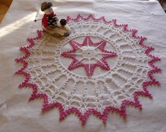 Handmade fuchsia pink and white cotton crochet lace doily.