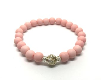 Pink bracelet with silver balls of thread