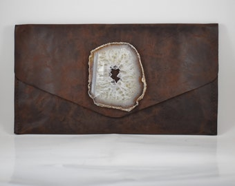 handmade brown cow leather envelope style clutch with a white geode crystal