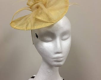 Small ladies yellow fascinator with stunning feathers and flower detail!
