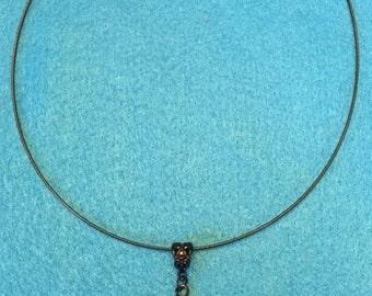 Black necklace with a black lace pendant