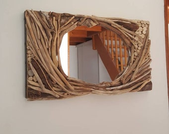 Oval mirror with all these wood floats and these little log coming on its panoramic frame