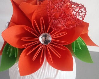 White vase (ball of yarn with button and needles) and origami kusudama bouquet 5 flowers